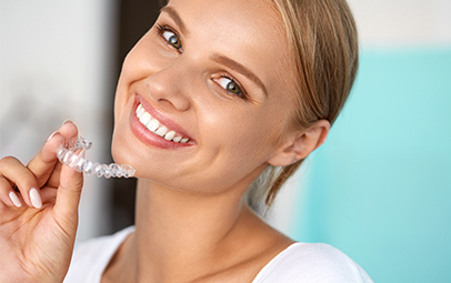 woman smiling with invisalign